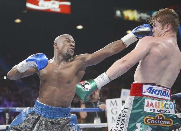Click here to find out more! Floyd Mayweather Jr. dominates, gets decision over 'Canelo' Alvarez